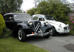 picture of two classic french cars